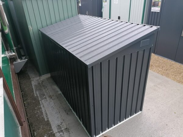 The bin store as seen from behind. The lid is reflecting the sun above so it is brighter in appearance than the rest of the unit