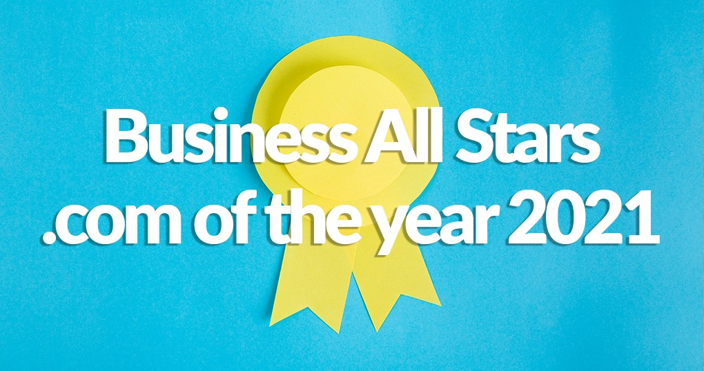 A yellow ribbon against a bright blue cloth backdrop. The ribbon reads 'Business All Stars .com of the year 2021'