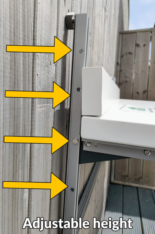 A side view of the balcony table showing the 4 ports that can be used to adjust the height of the unit