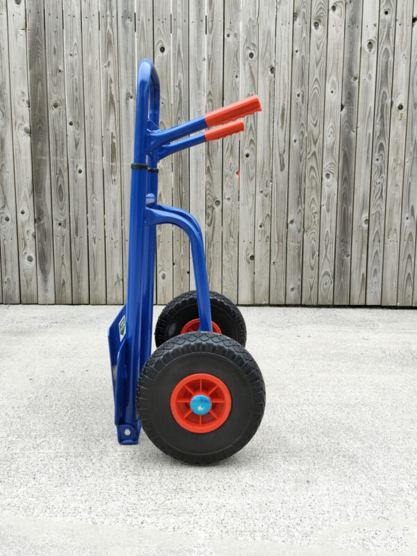 A side profile view of the compactable hand truck from sheds direct ireland in it's smallest form