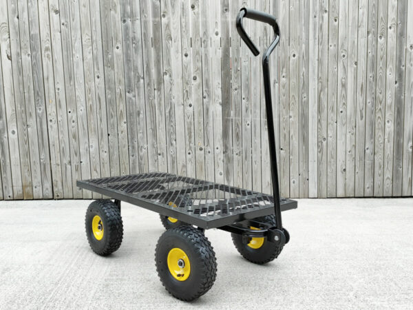 The mesh cart without any panels, presenting as a flatbed. The handle is still in the upright position and the yellow from the rims of the tyres are visible