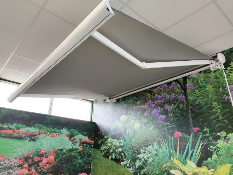 The awning full assembled and protruded from the cassette