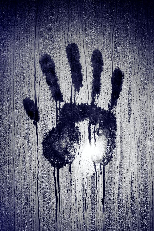 hand print on window due to condensation in steel sheds