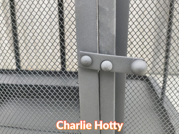 A macro detail of the locking mechanism of the Charlie Hotty Fire pit