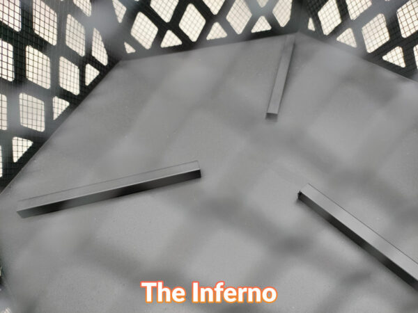 The inside of the Inferno fire pit showing three thin bars to
