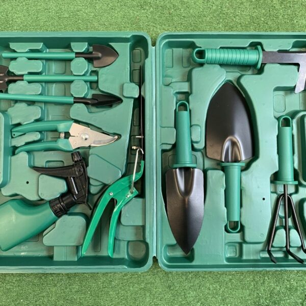 All the items of the garden tool box displayed in the box.