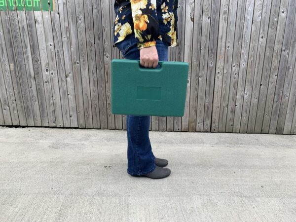 Woman holding the garden tool box by the handle