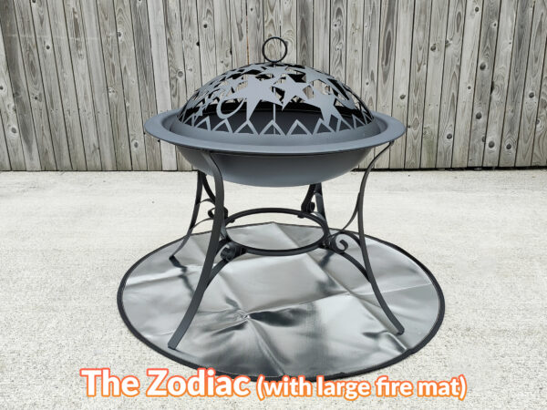 The zodiac fire pit standing on a reflective, circular fire mat. The mat is perfectly sized to suit under it.