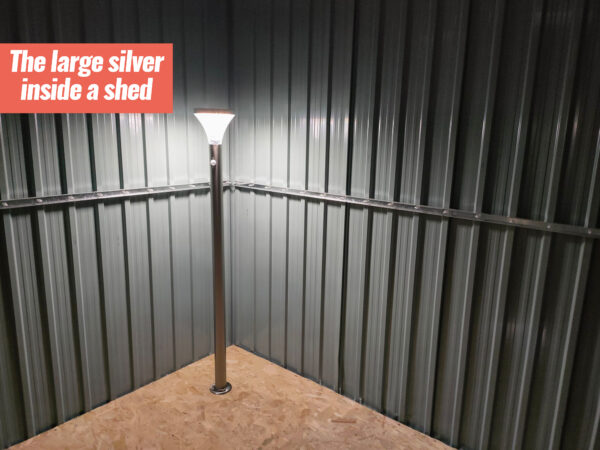 The large silver LED Garden light illuminating the inside of a silver garden shed
