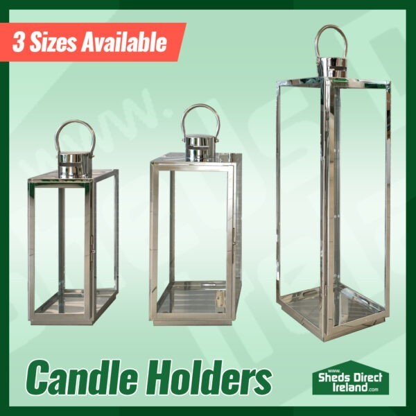 The three sizes of the lantern-style candles holders side by side on a green background. They are in order ascending in height.