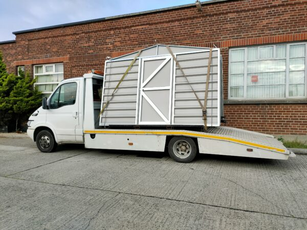 A heavy duty shed on the back of a van. It's in individual sheets and they are very tall.