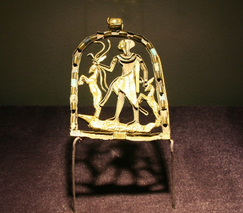 The Greek God Shed in a golden panel. He is facing to the right and carrying to deer by the horns