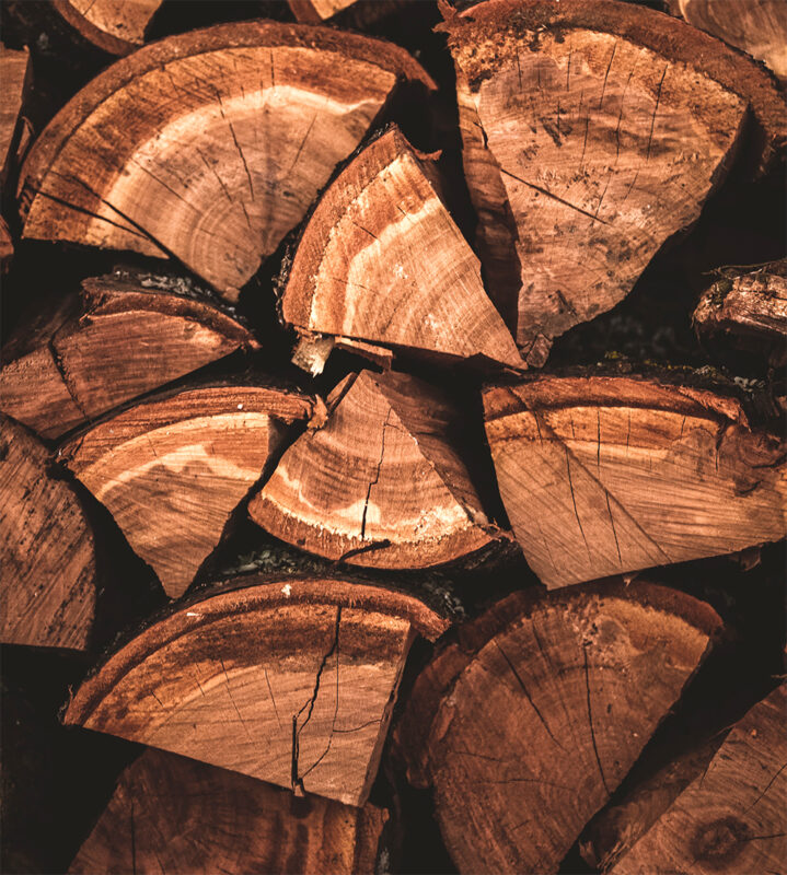 Image of a number of blocks of dry wood. This is the best wood in terms of fire pit safety