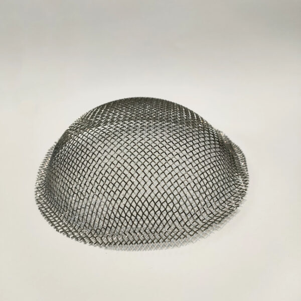 A Mesh dome for a camping stove on a white backdrop